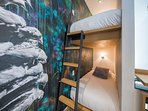 Recessed ceiling and wall lighting make the bunks bright and cozy.