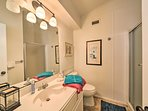 A second full bathroom provides a walk-in shower.