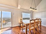 Enjoy formal meals at the 5-person dining table.