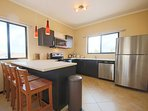 Fully equipped open kitchen with 4-bar seats
