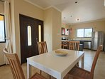 Condo entrance and 4-seat dining table