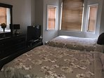 family two queen beds in large one bedroom suite