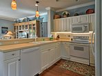 Whip up home-cooked meals with ease in the fully equipped kitchen.