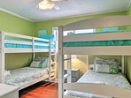 Kids will sleep well in the twin-over-twin bunk beds.