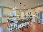 The fully equipped kitchen boasts a large island with bar top seating.