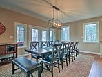 Share home-cooked family feasts at the elegant dining table with seating for 12.