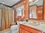 Choose between a soak in the tub or rinse in the shower in this bathroom.