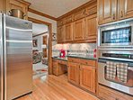 Wooden cabinets and hardwood flooring make this classic kitchen feel homey.