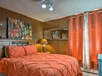 Warm and cozy bedroom features a queen bed.