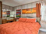 This room is adorned with vibrant decor and a TV with DVD player.