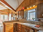 Enjoy making home-cooked meals in the well-equipped kitchen.
