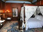 'Master' bedroom, with ensuite bathroom. All castles should have lots of four poster beds.