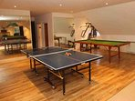 Above the indoor pool is this well equipped games room