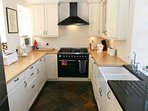 The kitchen is compact, modern and well designed with an impressive range cooker