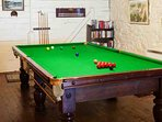 The games room with 3/4 size billiard table is located in an outbuilding