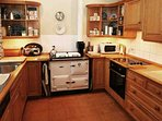 The kitchen has a traditional Rayburn Range and electric hob