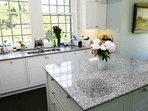 The kitchen is large and bright with granite worktops