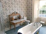The spacious and chic ensuite bathroom to the four poster room