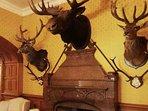 The reception hall has an impressive array of stuffed animal heads