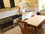 The kitchen is small but mighty with 12 gas rings and 4 double ovens
