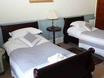 Room 2 is the first floor twin room with single sleigh beds