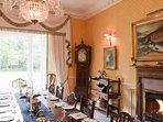 Formal dining room with fine mahogany dining table and chairs,