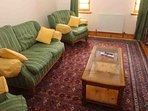 The TV room is a cosy room located by the sitting room