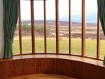 There are fine views over the open moorland from the sitting room