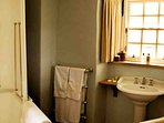 The vintage canopy bath with surround shower is a feature