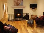 The sitting room has a cosy log burner to add to the warmth