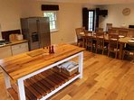 The kitchen has underfloor heating and is ideal for a large group holiday