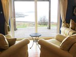 It is the magnificent view that is the focus in the sitting room