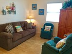 Cozy, comfortable family room with lots of natural sunlight and an entertainment center.