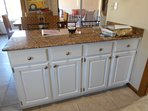 Newly refinished kitchen Breakfast Bar stools on back of photo
