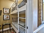 1st Floor bunk room with wall-mounted tv