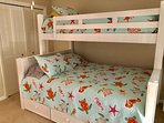 The 3rd bedroom has a full bed with a twin bunk over it.