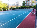 Tennis court for play and exercise. Equipment available upon req