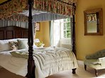 The Regency bedroom with an antique four poster 5' bed