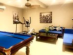 Spacious gym, with private toilet room, gym equipment, SMART TV, pool table and air con