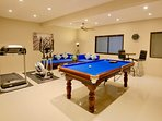 Large games room with Pool table, gym equipment, smart TV and plenty of seating