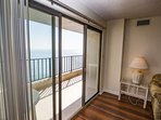 Large window and sliding glass door to let the sunshine in.