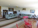 Sit and relax in the bright living room at Oceans Playground Cottage