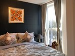 The bright and spacious bedroom with Hermes fabrics
