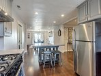Kitchen opens to the Formal Dining and Family Room