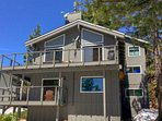BBQ, dine, sunbathe and stargaze above Lake Tahoe from huge furnished wraparound middle floor deck.