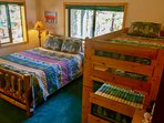 Third bedroom has 3 beds - twin bunkbeds + lodgepole queen bed. Bottom floor.