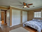 Sleep comes easy in the master bedroom with a king-sized bed.