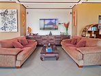 Super sized sofas and 65' TV with satellite TV and NETFLIX etc