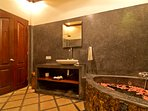 En suite with XL corner bath and rain shower