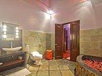 Ensuite bathroom with XL corner bath and rain shower